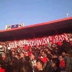 Crowds in Tiraxtur al-Jari hold banner, &quot;South Azerbaijan is not Iran,&quot; February 2013.