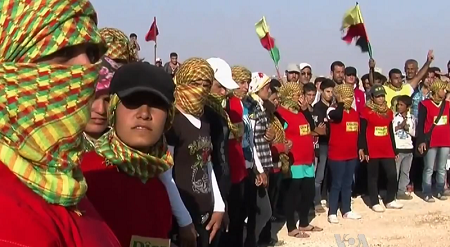 PYD supporters at a funeral for a local of a village outside of Afrin, Syria, in 2012.