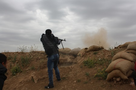 YPG fighters in action during an ISIS attack on Haj Ismail village, April, 2014