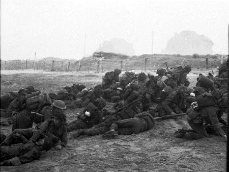 Soldiers under fire on Queen sector of Sword Beach