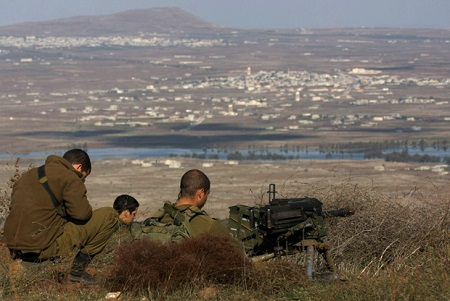 Israeli soldiers in an abandoned military outpost overlooking the ceasefire line between Israel and Syria on Tal Hazika near Alonei Habshan.