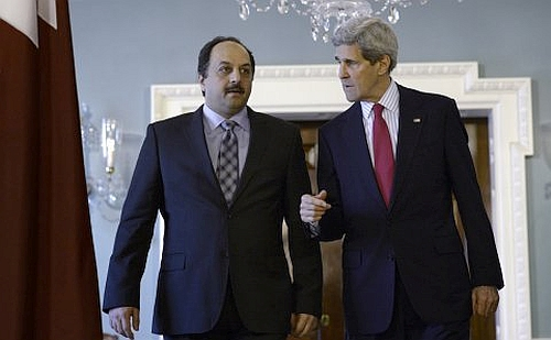 U.S. Secretary of State John Kerry with Qatari Foreign Minister Khalid Al Arriya in Washington, April 2014.